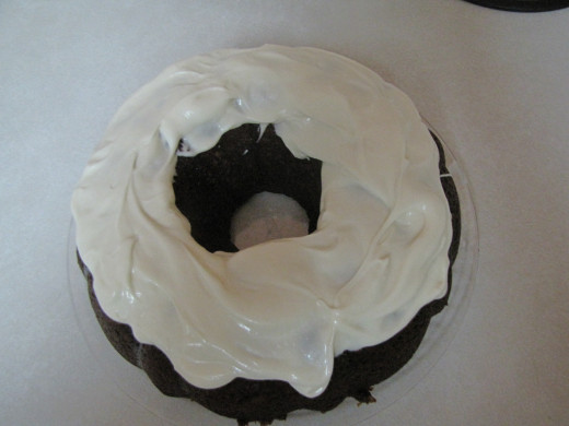 If you made a bundt cake, frost just the top with cream cheese frosting.