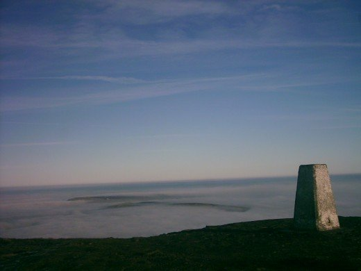 Pendle Beacon above cloud