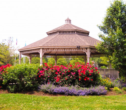 Close up of the gazebo with  memorial gardens in full bloom.