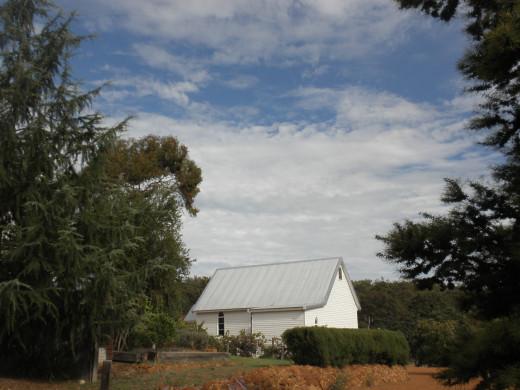 around the whitewashed church where no one pray any more,