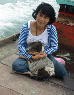 Sabrina with the first dog (now named Hope) she rescued from Pulau Ketam