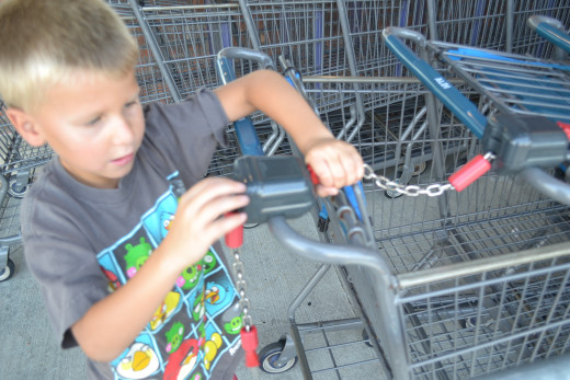 Son reattaching grocery cart at Aldi