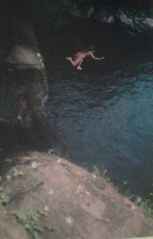 The author taking a jump off of a rock in West Virgina.