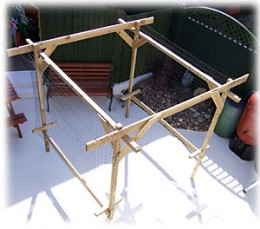 Build A Frame Like The Above Photo To Grow Your Vertical Vegetables On. Once You Have The Frame Up Build Walls With Hog Wire And Cover The Top With Hog Wire. Be Sure To Put A Entrance Door In.