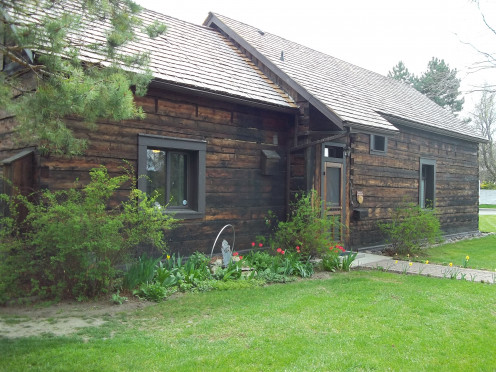 """Gunshot holes pock mark the interior of this cabin...the wild bunch of MacDougalls liked to shoot around the house...actually """"in"""" the house.  It is presently a private residence rented to a music teacher by the city of Kelowna."""