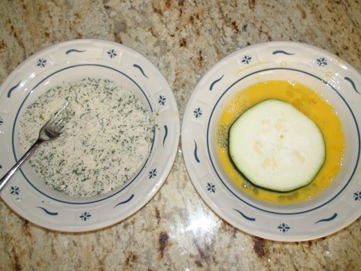 Egg and bread crumb mixture in separate bowls to dip zucchini before frying in olive oil.
