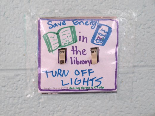 A kid-created reminder to turn off the lights and save energy.