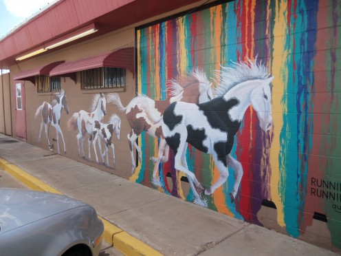 "A beautiful mural painted on the outside wall of the ""Rockin'Y's Roadhouse"" restaurant on Route 66 in Tucumari, New Mexico. They have some great food here!"