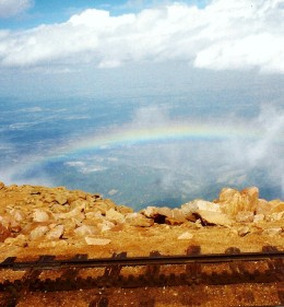 Rainbow seen from the top of Pikes Peak looking down.
