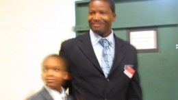 A proud father embraces his son after he was baptised at 9 years old.