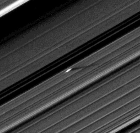 An unusually large propeller feature is detected just beyond the Encke Gap in this Cassini image of Saturn's outer A ring taken a couple days after the planet's August 2009 equinox. The unique geometry of equinox has thrown into relief small moonlets