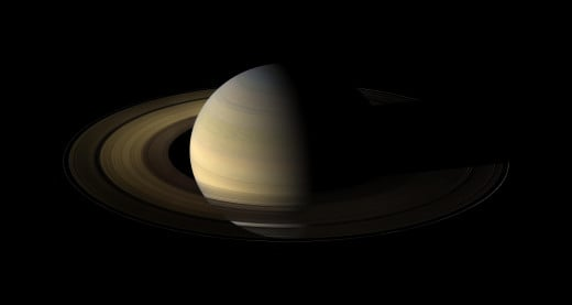 Saturn has well over 60 moons. It is like a mini solar system, with the moons orbiting like planets around the Sun.