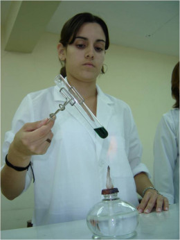 A scientist in her lab coat.