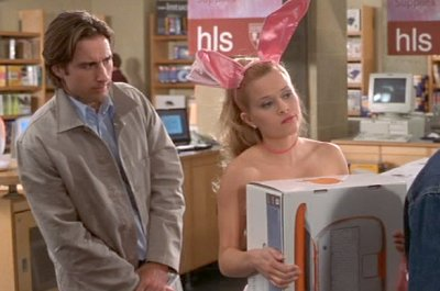 "In Legally Blonde, Reese Witherspoon plays a woman transforming from ""doll"" to ""lawyer,"" in pursuit of her smarts, she purchases this MAC computer."