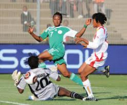 Stella Mbachu of Nigeria slots the ball into the back of the net past ...