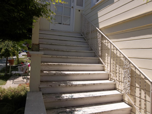 Beautiful old wrought iron raiing added to stairway to upstairs entry
