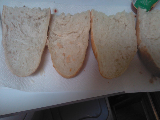 Then cut each section in half to get four large pieces of French Bread