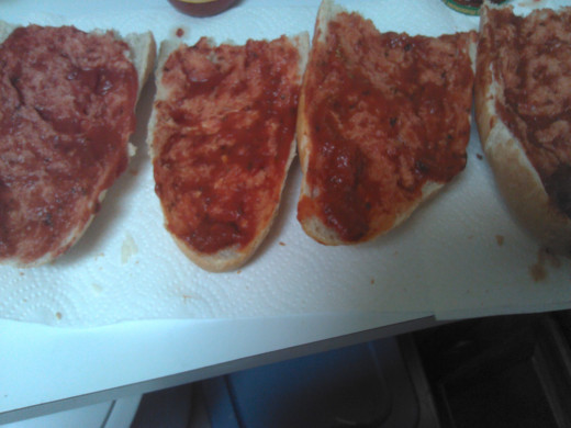 Spread Pizza Sauce over French Bread