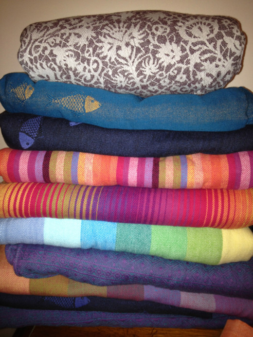 Babywearing Stash Shot - a pile of woven wraps.