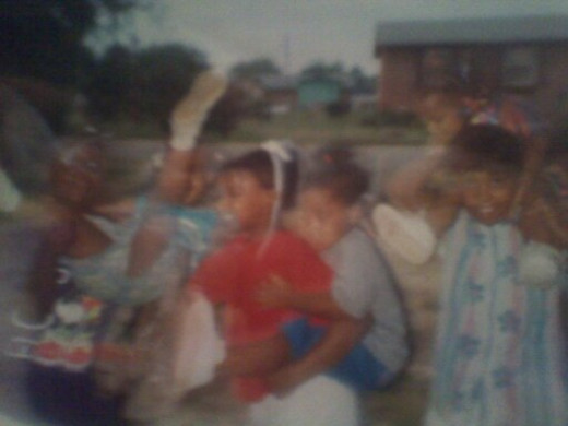 Latecia with the girls sporting her baby bop outfit. She is the one on far right on my shoulders of course!
