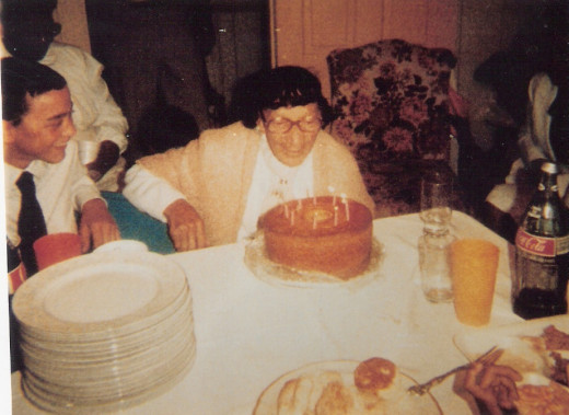 Big Mama blowing out the birthday candles.