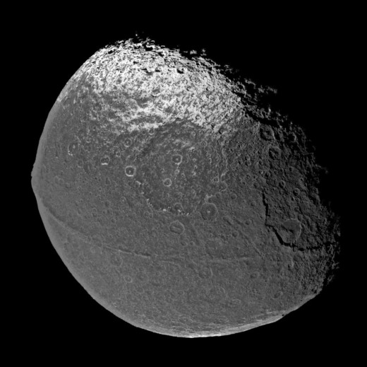 The leading hemisphere of Iapetus (the hemisphere facing the direction of orbit) is so dark it can nearly disappear from view when observed from Earth