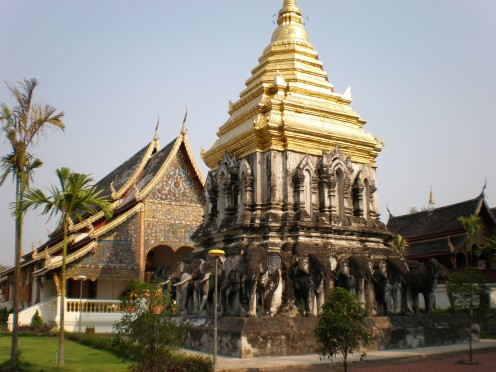"The characteristic ""chedi"" and sculpted elephants, distinctive of northern Thai architecture. Wat Chiang Man, Chang Mai old city, Thailand."