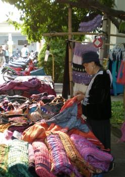Handmade cloths vendor. Street photography at Chang Mai Night Bazaar, Thailand.
