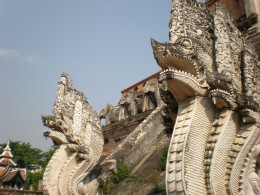 """Detail of the main Buddhist temple´s staircase, gigantic """"naga"""" (serpent deities in Hindu and Buddhist mythology). Wat Chedi Luang, Chang Mai, Thailand."""