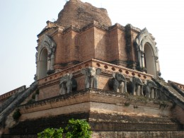 Sculpted elephants at the top of the main chedi. Wat Chedi Luang, Chang Mai, Thailand.