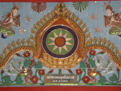 Detail of huge exterior mosaics in Buddhist Temple of Wat Meh Thang, Old City Chang Mai, Thailand.