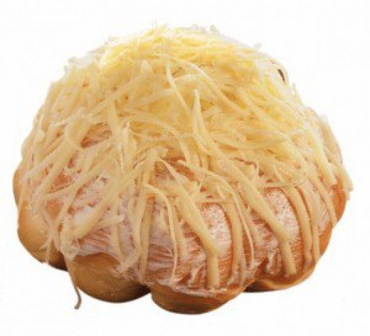 Ensaymada sprinkled with cheese