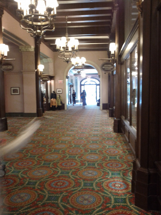 Gracious corridors are filled with decorated Christmas Trees throughout December