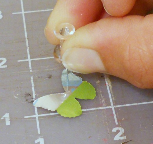 Using a thumbtack to pierce the metal