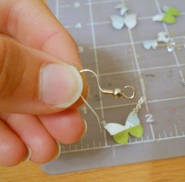 Open the earring hook's loop and attach is to the chain or jump ring
