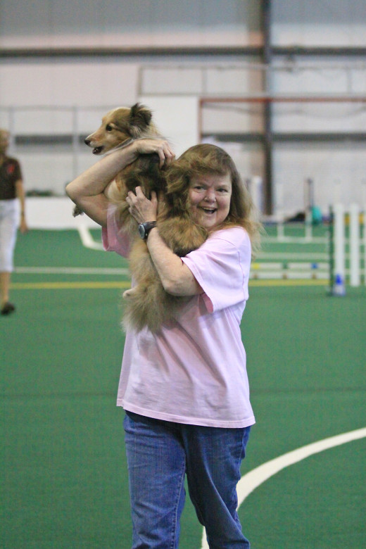 Aslan and his owner celebrating after an agility run.