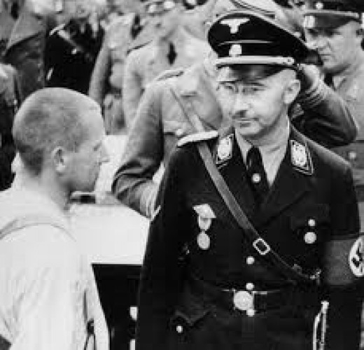 Himmler visiting the Dachau Concentration Camp in 1936.  I have purposely omitted the more ghoulish and sickening photos.
