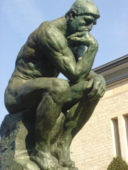 """Sculpture of """"Thinking Man"""" by Rodin, Paris, France."""