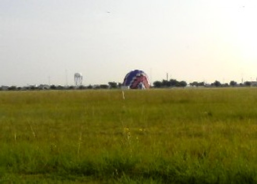 Allowing the air to continue escaping helps to collaps the balloon so it can be packed away.