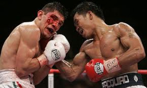 Manny Pacquiao blasting out David Diaz to win the lightweight title. Pacman ended up capturing 8 championships in 8 different weight classes.