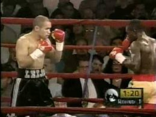 Azumah Nelson squares off with Jesse James Leija. The two warriors fought 3 times as professionals.