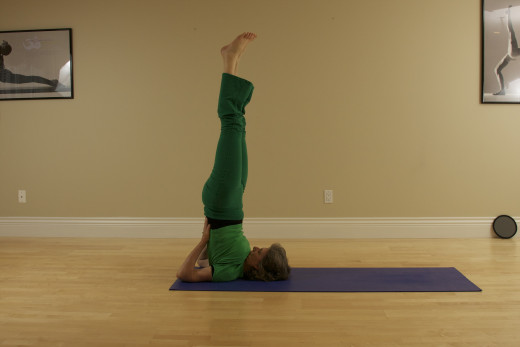 Shoulder Stand, or Sarvangasana, is one of the key postures, but simpler variations such as modified shoulder stand above, or lying on the back with the legs up the wall, have many of the same benefits.