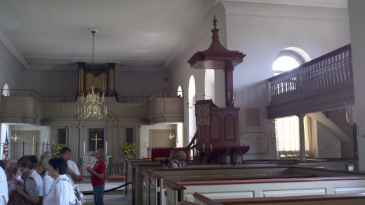 "A picture inside Bruton Parish of the pulpit.  Notice the ""sounding board"" on top to project volume and the elevated position of the pulpit also."