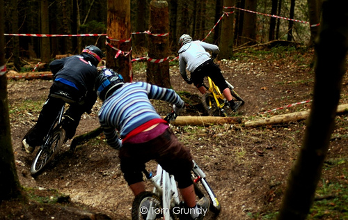 Riders showing the wrong technique of leaning into the turns, and inproper leg position