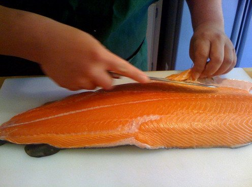 Filleting a salmon is easy to do.