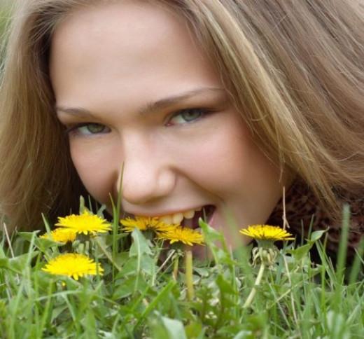 Girl eating dandelion flowers