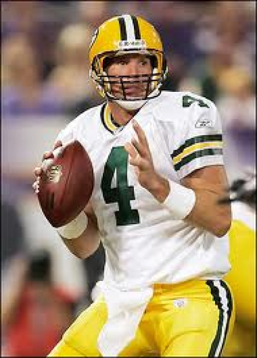 Brett Favre holds most of the passing records in the NFL. He has won two Super Bowls and he is a three time MVP.