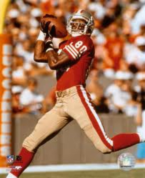 Jerry Rice is the top receiver in football history. He has the most touchdowns in NFL Football history as well.  His catches were made for highlights and sometimes they seemed impossible.