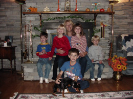 Grandma (me) with my grandchildren a few years back.