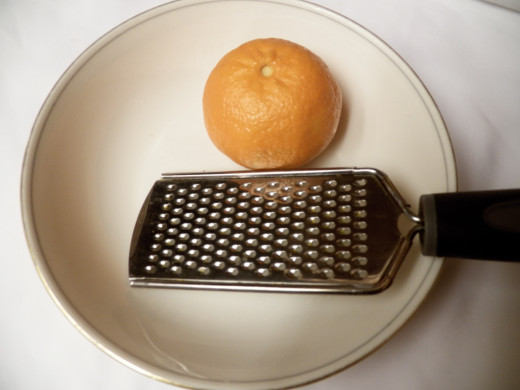 Small grater, orange and bowl.